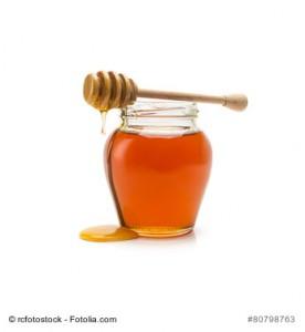 Pot of honey and stick
